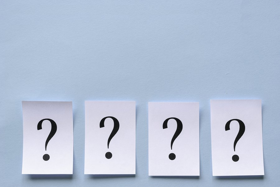 four question marks on a blue background