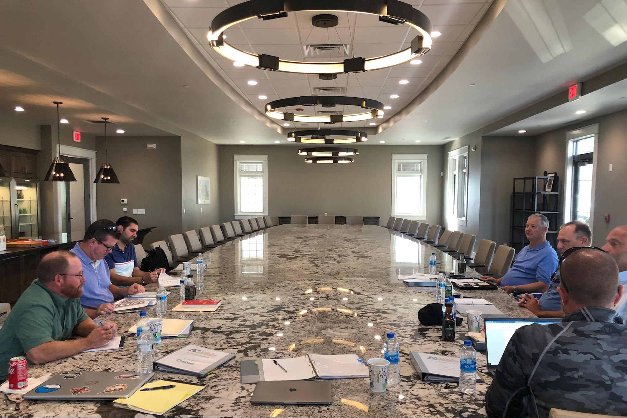 """lessons from a billionaire: This conference table redefines """"big"""" money."""